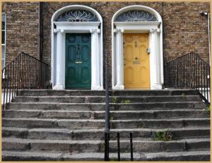 Green door and yellow door at the top of some steps