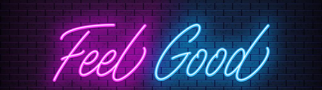 Feel Good neon sign on a black brick wall