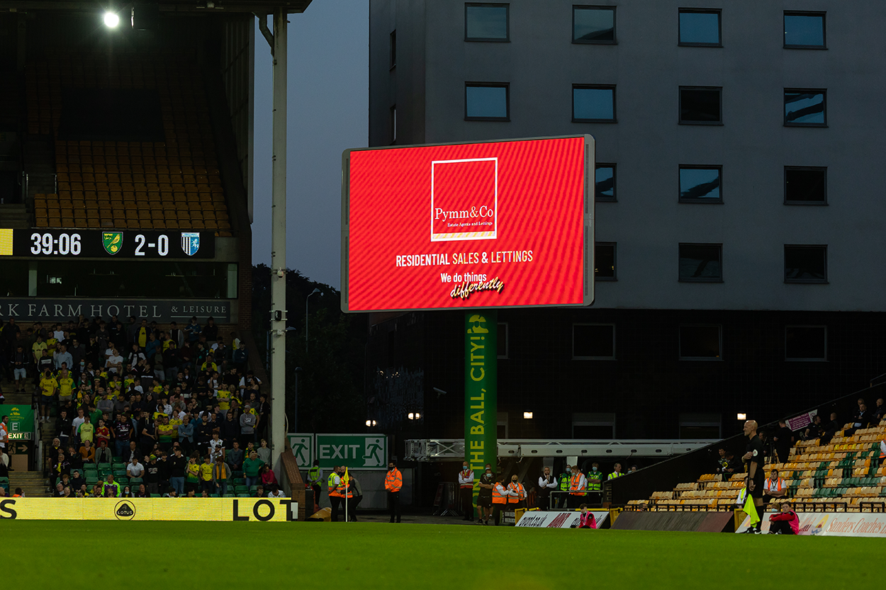 Regional Club Partners Pymm & Co on the big screen at Carrow Road home of Norwich City Football Club